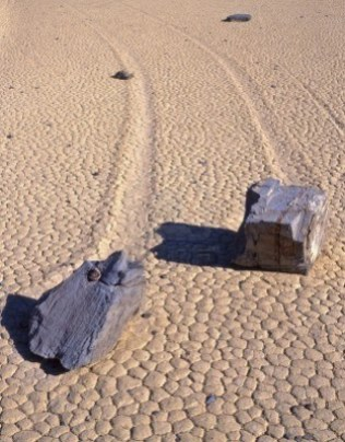 760734-two-rocks-and-their-trails-on-the-racetrack-playa-in-death-valley-national-park-california
