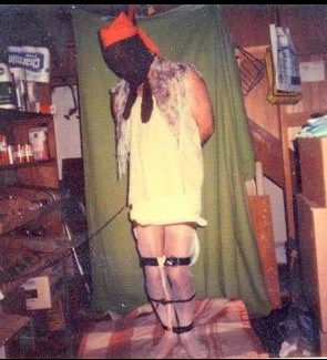 Photo of Dennis Rader wearing a victim's clothes. Photo taken in his basement.