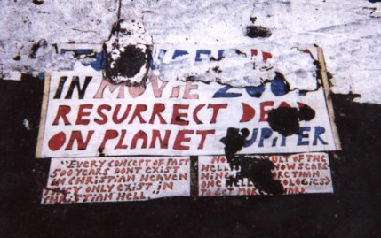 NYC Toynbee tile - W. 57th. & 7th. Ave. Photo from Jan. 1999
