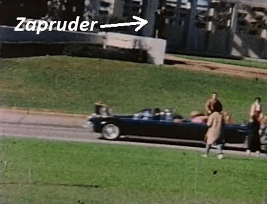 Photo of Zapruder standing on ledge filming