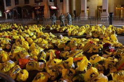 Bags holding items left behind by the marathon runners