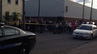 Crowd gathers outside the Cleveland house where the women were held