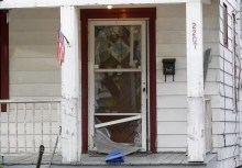 Front door of home that was kicked in by Charles Ramsey to rescue the three women