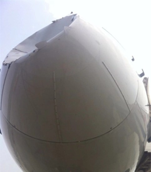 Close-up of damage to nose cone of Chinese Boeing 757 after collision with UFO