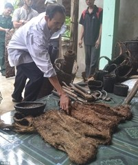 Authorities examine homemade tools used by the men to survive in the jungle wilderness