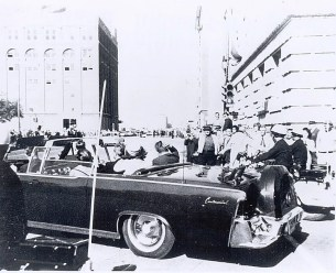 JFK's limo turning from Main to Houston. Sniper nest barely visible in school book depository.