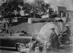 Original Mary Moorman photo - fingerprint left behind by careless investigator. Zapruder seen on wall in background.