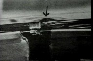 Damage to top windshield frame of Kennedy's limo