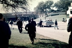 Witnesses rush towards the grassy knoll after John F. Kennedy was shot