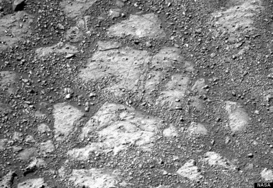 NASA photo showing flat bedrock before the appearance of the mystery rock