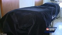 The body bag that 78-year-old Walter Williams was found struggling in