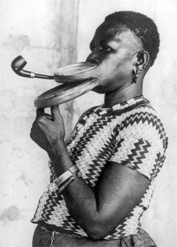 Madam Gustika of the Duckbill tribe smoking a pipe