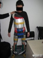 Hong Kong smuggler caught with 94 iPhones taped to his body