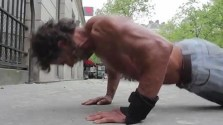 Homeless bodybuilder Sayagh Jacques working out on the streets of Paris