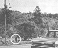 Barney Hill reenacts sighting for NICAP investigator in 1964. On actual night, UFO crossed highway from right to left over field, enabling Barney to watch it through binoculars.