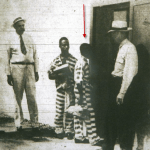 14-year-old George Junius Stinney, Jr. entering death row after his conviction for the deaths of 8-year-old Mary Emma Thames and 11-year-old Betty June Binnicker