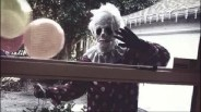 Wrinkles the Clown stalking outside a home