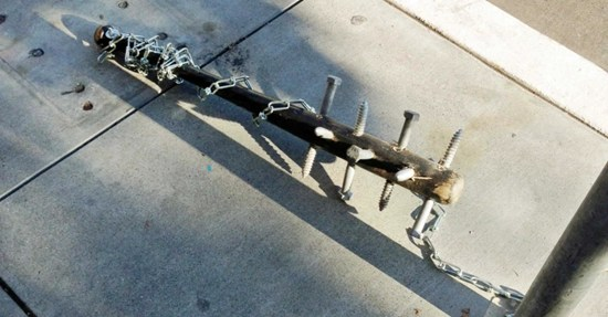 Police puzzle over dozens of creepy spiked baseball bats found chained to poles across San Francisco