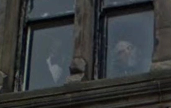 Ghostly figure peering from upstairs window of Stuart Hotel in Liverpool