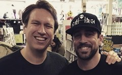 Aaron Rodgers (right) with comedian Pete Holmes