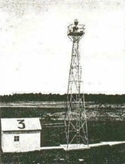 Early Transcontinental Airmail Route beacon tower, generator station, and concrete arrow