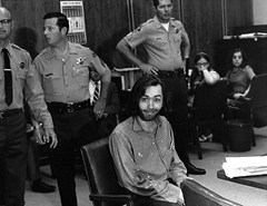 Charles Manson in court sticking out his tongue
