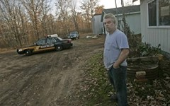 Steven Avery waits outside while Manitowoc County officers search his property