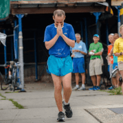 A runner completes the Sri Chinmoy Self-Transcendence race