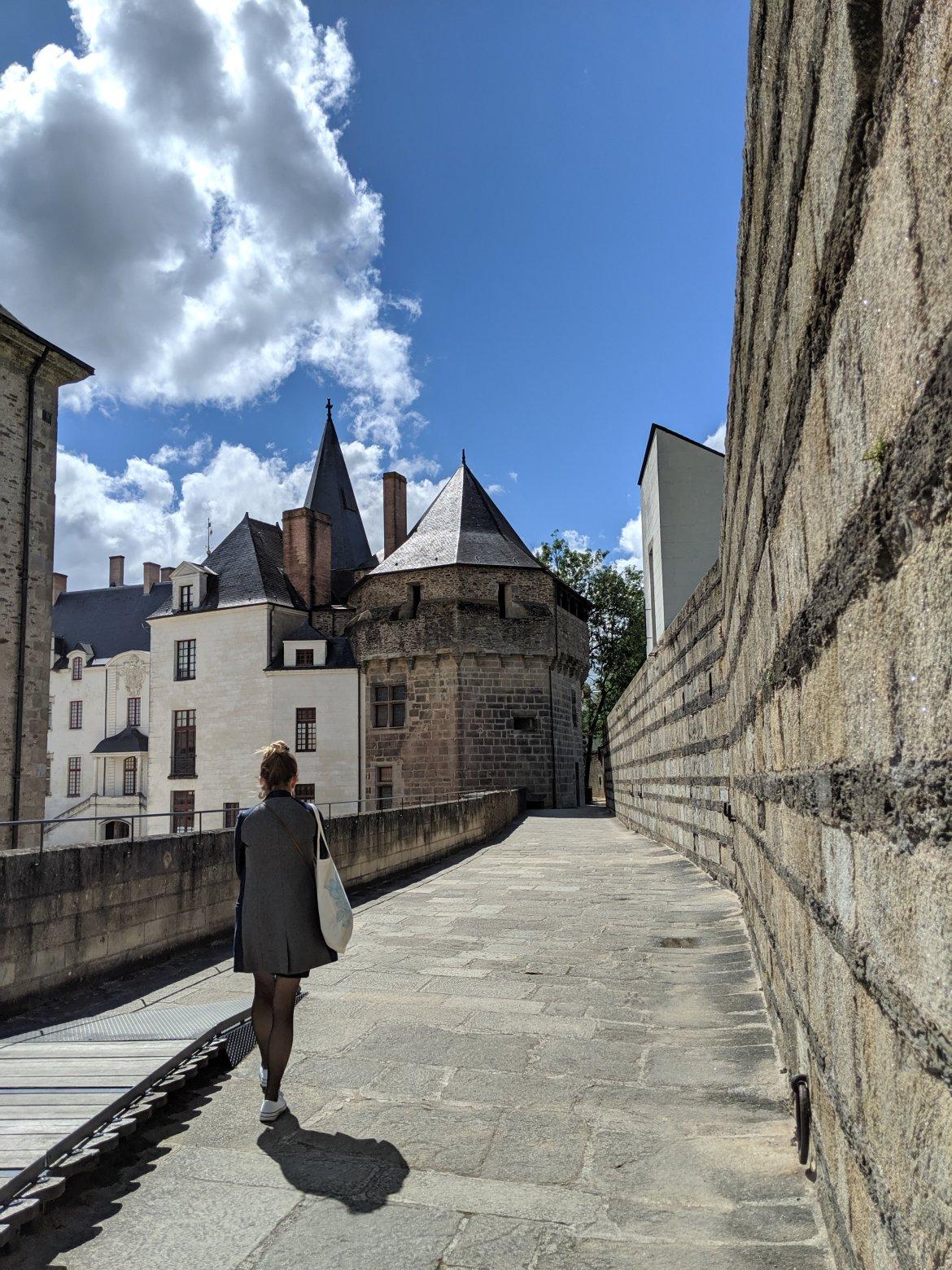 Girl walking in castle in Nantes, France