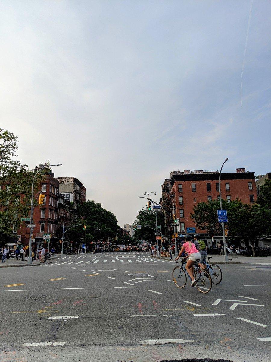 bikers crossing Houston St in NYC