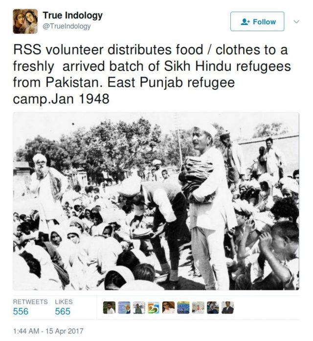 TrueIndology: RSS volunteer distributes food/clothes to a freshly arrived batch of Sikh HIndu refugees from Pakistan. East Punjab refugee camp. jan 1948
