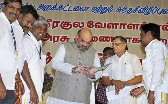 BJP president Amit Shah with S. Gurumurthy, co-convenor, Swadeshi Jagran Manch, at the Devendrakula Velalar conference in Madurai