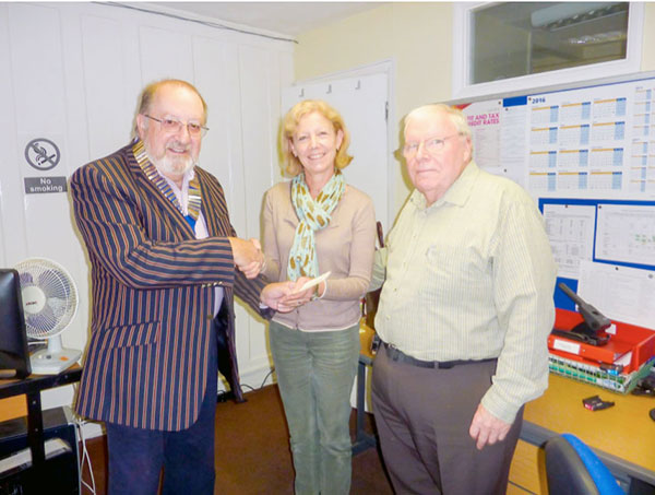 Lion President Mike Gwynne (left) making the presentation to Juliet Hawkins & Lofty Callow of Citizens Advice Alton.