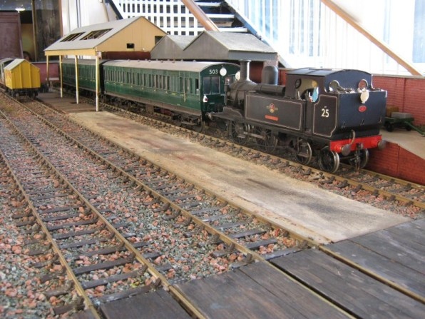 A train departs the station on the Gauge 3 Warton Road