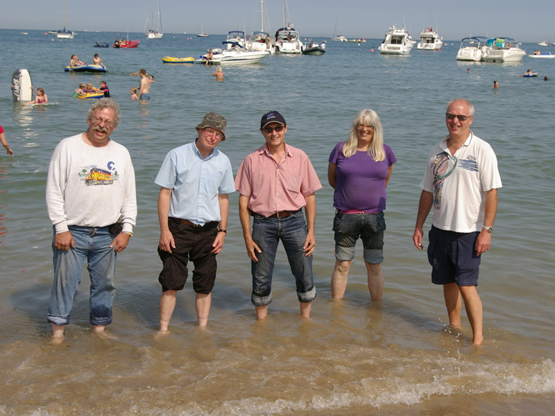 Members at the beach – from left, Richard Pretious, John Coates, Steve Cook, Diane Kivi, Graham Smith