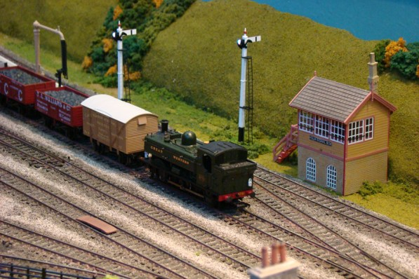 A GWR Pannier departs with a goods train on Holm