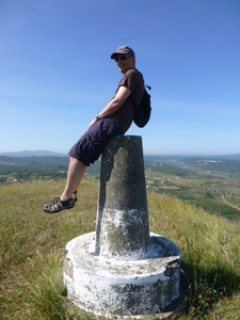 Tim-sitting-on-top-of-Penela-Hill-balancing