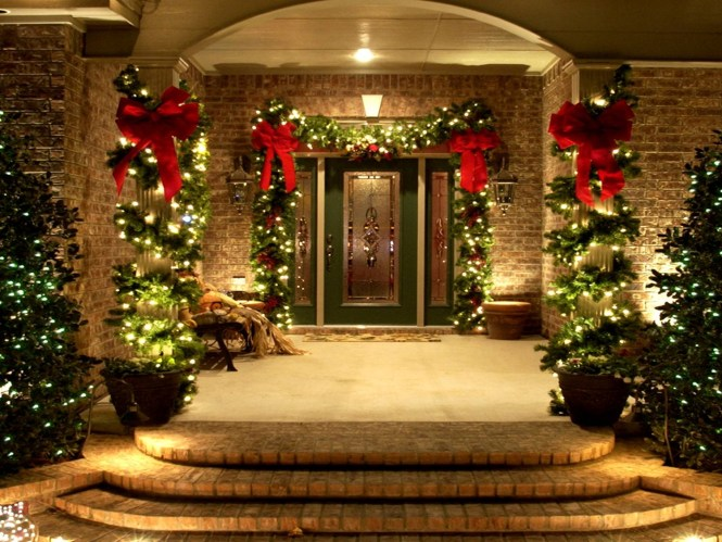 Front Entry With Decorations Such As Garland Hanging Baskets Wreaths Lighted Reindeer And