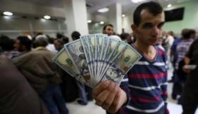 يديعوت أحرونوت تتفاجئ من الطريقة الجديدة لصرف المنحة القطرية في غزة
