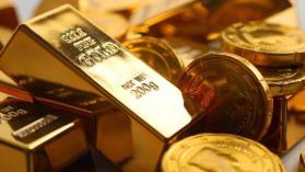الذهب يهبط مع صعود الدولار بعد بيانات أميركية قوية
