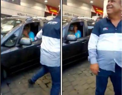 شاهد.. لحظة ضبط لبناني تنكر في زي امرأة داخل محطة وقود في بيروت