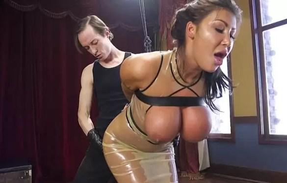 BIG TITS LATEX SLAVE SERVES HER MASTER IN DUNGEON