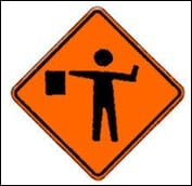safer driving with warren buffett, symbolized by a roadside traffic sign for flagman