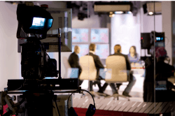 people in a tv studio, symbolizing why you won't see us on cnbc