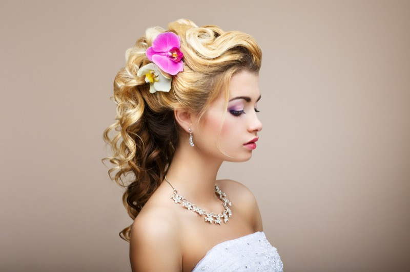beautiful bride showing off her new wedding day hairdo from boston s amaci salon