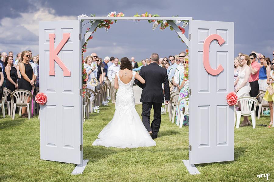 Vineyard Wedding with doors to ceremony | Palisade Winery Wedding Photographer
