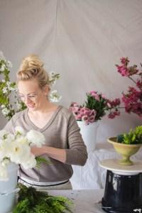 Kelly Mendenhall of 3 Leaf Floral arranging a centerpiece