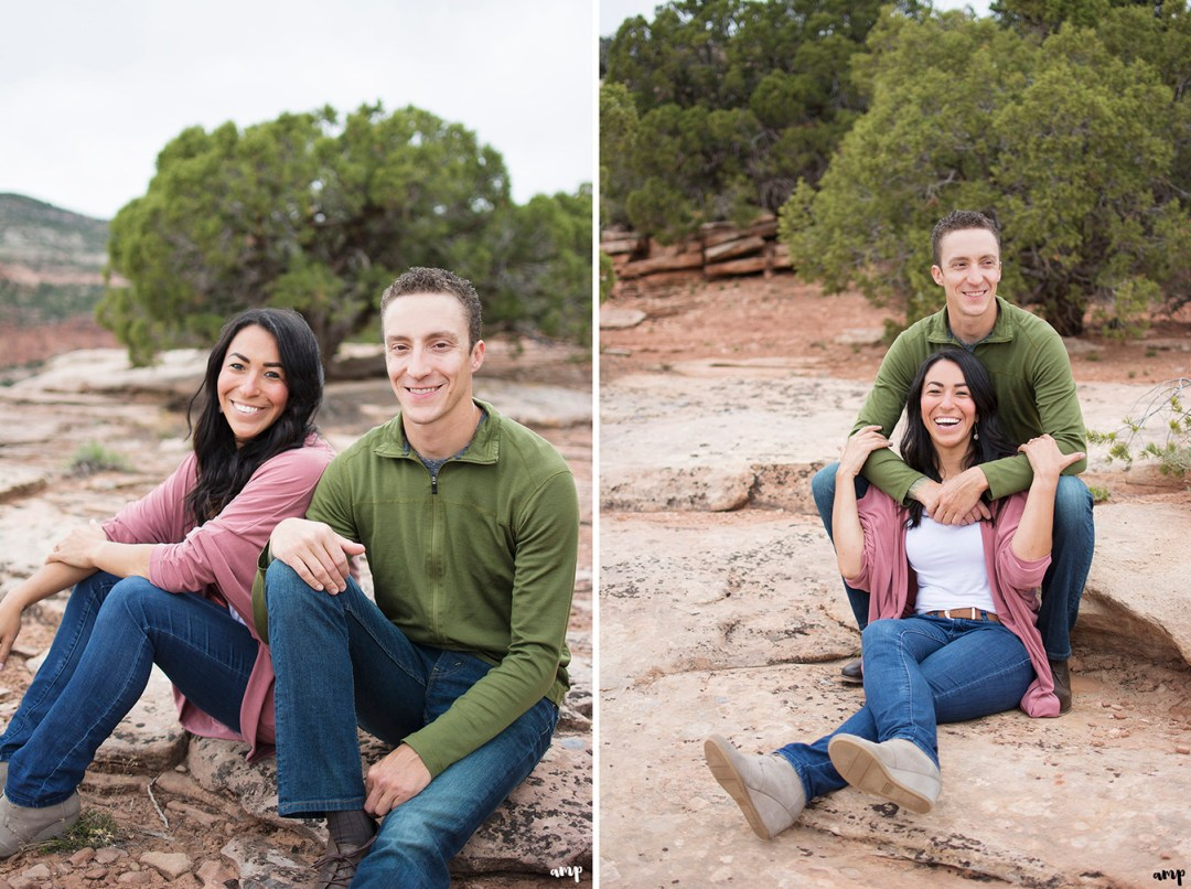 Couple sitting and laughing in the desert of the Colorado National Monument