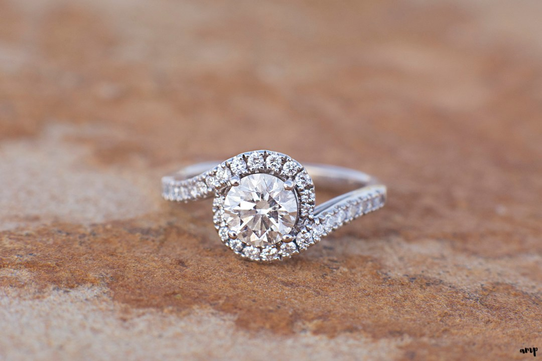 Engagement ring detail shot on red rock