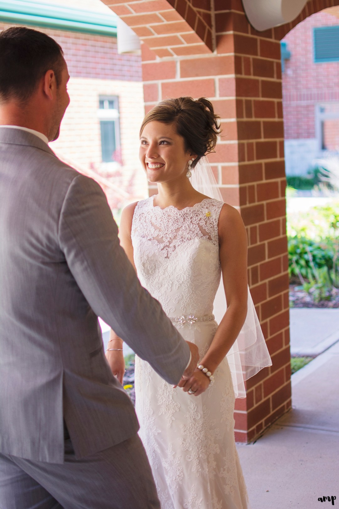 Bride & groom's first look in church courtyard